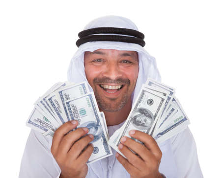 arabic currency: Portrait Of Mature Arab Man Holding Dollars Over White Background