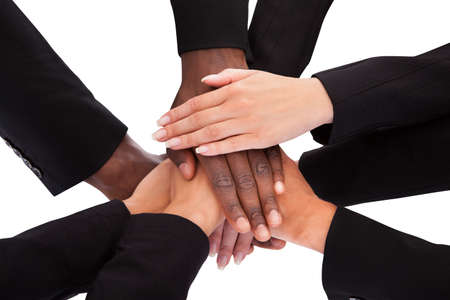 Low Angle View Of Multiracial People Stacking Hands Over Each Other photo
