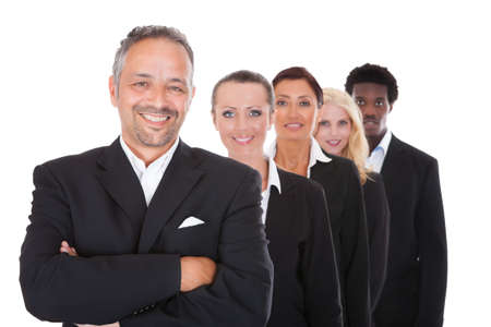 Happy Group Of Business People Standing In A Row Over White Background photo
