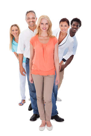 Group Of Multi-racial People Standing In A Row On White Background photo