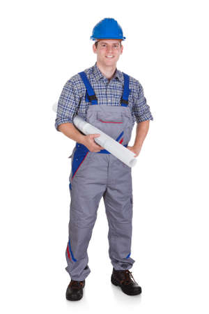 tradesmen: Happy male construction worker standing on white background Stock Photo