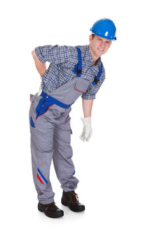 handglove: Male Worker Suffering from Pain isolated Over White Background