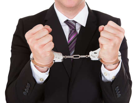 Portrait of criminal businessman isolated over white background photo