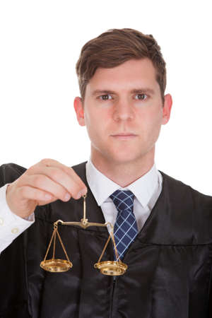Male Lawyer Holding Weight Scale Over White Background photo