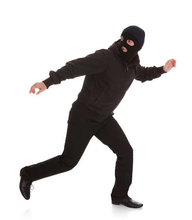 escape: Man Wearing Mask Running Over White Background Stock Photo