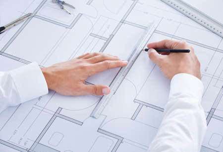 Close-up Of Male Architect Working On Blueprint At Desk Stock Photo - 21477863