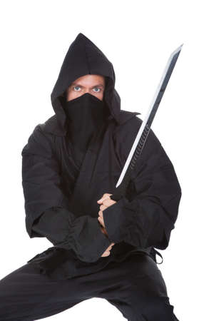 black belt: Portrait Of Male Ninja With Weapon Isolated Over White Background Stock Photo