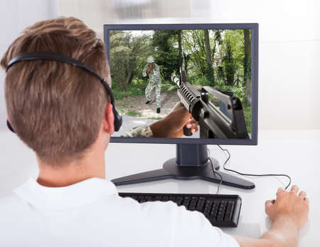 computer game: Photo Of Young Man Playing Computer Games