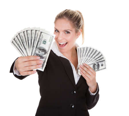 winning woman: Happy Businesswoman Holding Us Dollar Note On White Background