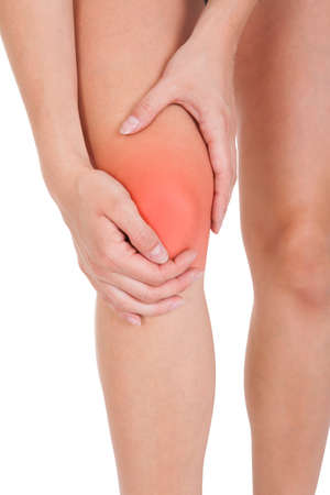 anatomy knee: Close up of woman leg injury isolated on white background