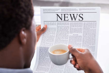 american media: Portrait Of A Happy Businessman Reading Newspaper