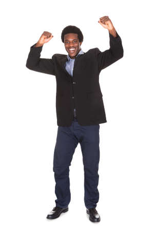 excited man: Portrait Of Happy Young Excited Businessman Over White Background Stock Photo
