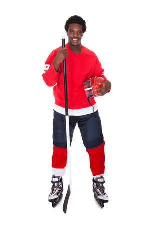 Portrait Of African Ice Hockey Player Isolated Over White Background photo