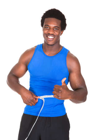 Happy Bodybuilder Measuring His Waist Showing Thumb Up Sign