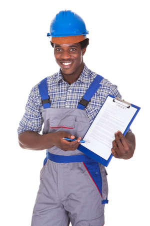 Young African Craftsman Holding Contract Form Isolated Over White Background photo