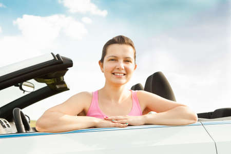 cabrio: Happy Young Woman Sitting In Her Car