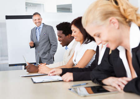 Businesspeople Sitting In Office At The Presentation Stock Photo - 21668240