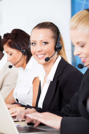Happy Co-workers Wearing Headsets Working In Call Center photo