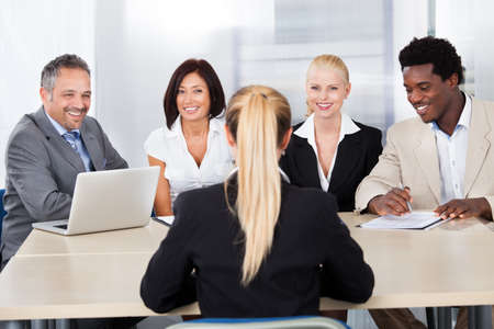 recruiting: Portrait Of Female Woman Sitting At Interview