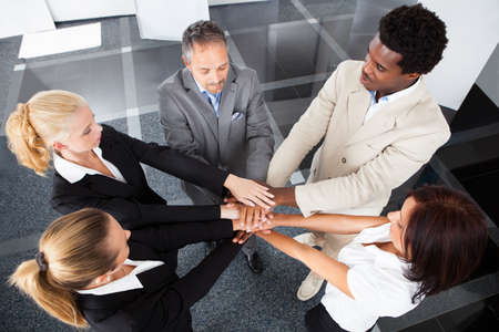 High Angle View Of Multiracial Businesspeople Stacking Hands Over Each Other photo