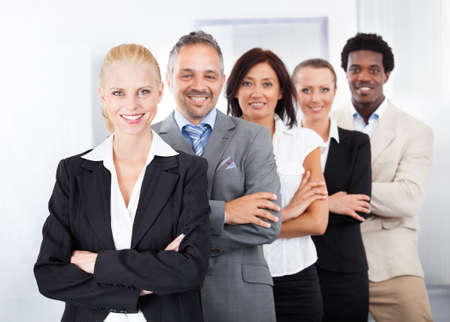 Group Of Happy Multiracial Businesspeople Standing In A Row photo