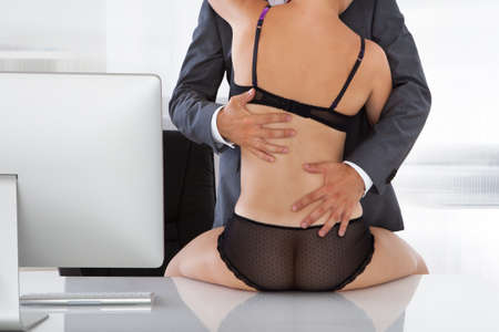 female sex: Portrait of a couple having sex in office