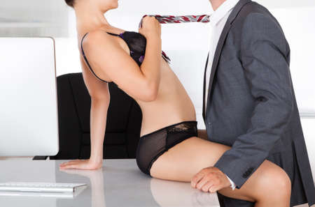 Sex: Portrait of a couple having sex in office