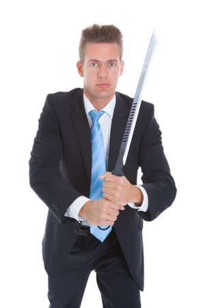 Young Businessman Standing With Sword Over White Background Stock Photo - 21668746
