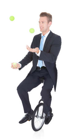 juggler: Happy Businessman Juggling Ball Sitting On Unicycle