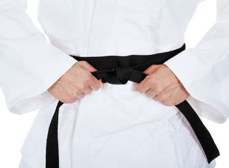 arts backgrounds: Young Man In Kimono Practicing Karate Over White Background Stock Photo