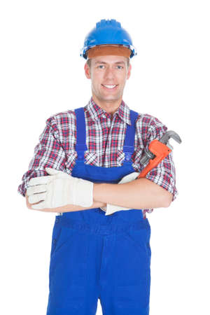 Portrait Of Young Male Worker Isolated Over White Background photo