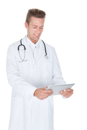 Portrait of friendly doctor with digital tablet. Isolated on white photo