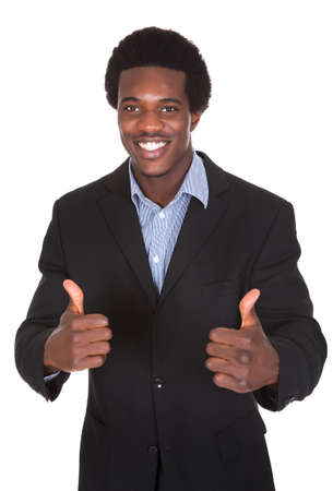 Portrait Of A Young Businessman Showing Thumbs Up Sign photo