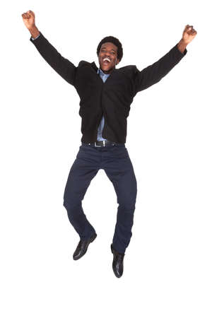 Portrait Of Happy Young Excited Businessman Over White Background photo