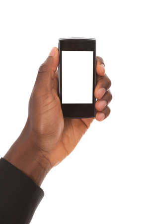 african business man: Close-up Of An Businessmans Hand Showing His Smart Phone Isolated Over White Background Stock Photo