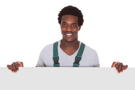 Happy Male Gardener Holding Blank Card Over White Background photo