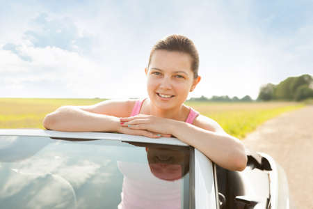 roofless: Young Woman Leaning On Windshield Of Roofless