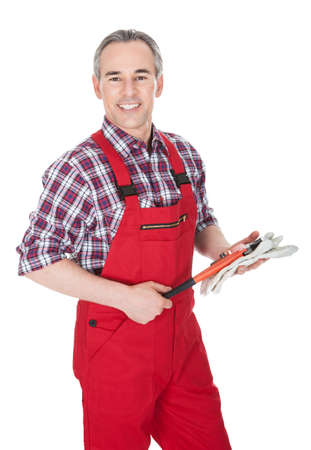 handglove: Mature Man Holding Wrench isolated on White Background Stock Photo