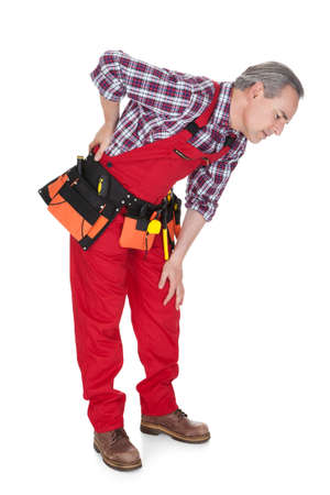 Male Technician Suffering from knee Pain isolated Over White Background photo