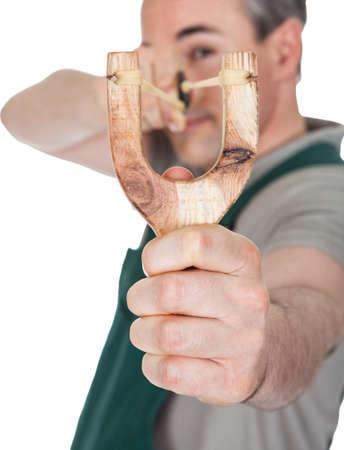 pull toy: Primer plano de la honda tirando mano disparó sobre fondo blanco Foto de archivo
