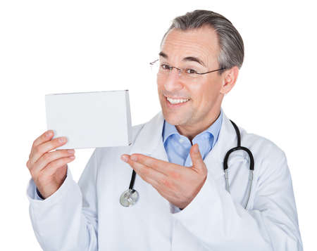 Doctor holding prescription note isolated on white background photo