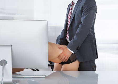 having sex: Portrait of a couple having sex in office