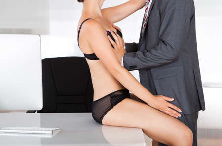 sex girl: Portrait of a couple having sex in office