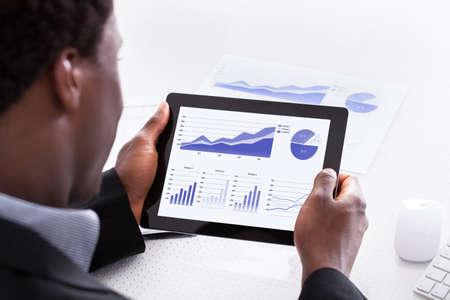 african businessman: Close-up Of Businessman Looking At Digital Tablet