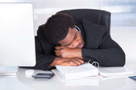african businessman: Portrait Of Stressed Businessman Sleeping In Office