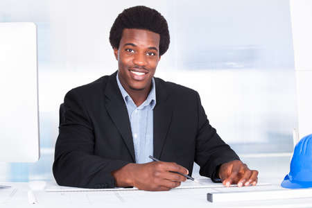 Portrait Of Happy Architect With Blueprint In The Office Stock Photo - 21864255