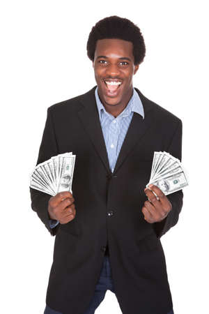 win money: Excited Businessman Holding Dollar Currency Isolated On White Background Stock Photo