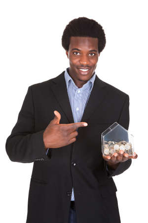 financial advisors: Young African Businessman Showing His Money Box Isolated Over White Background