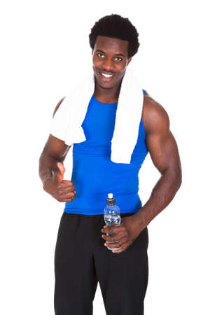 Portrait Of Young African Athlete Holding Water Bottle In Hand After Exercising Stock Photo