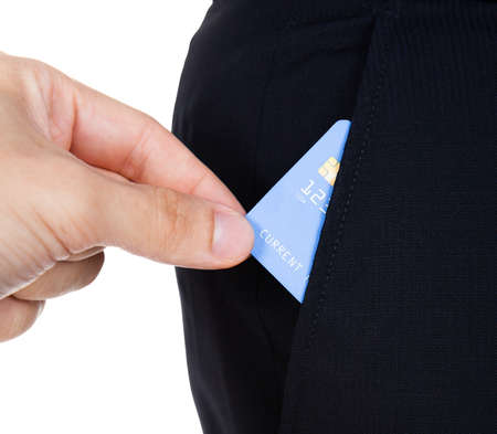 hand in pocket: Close-up Of Hand Taking Credit Card Out Of Pocket Over White Background